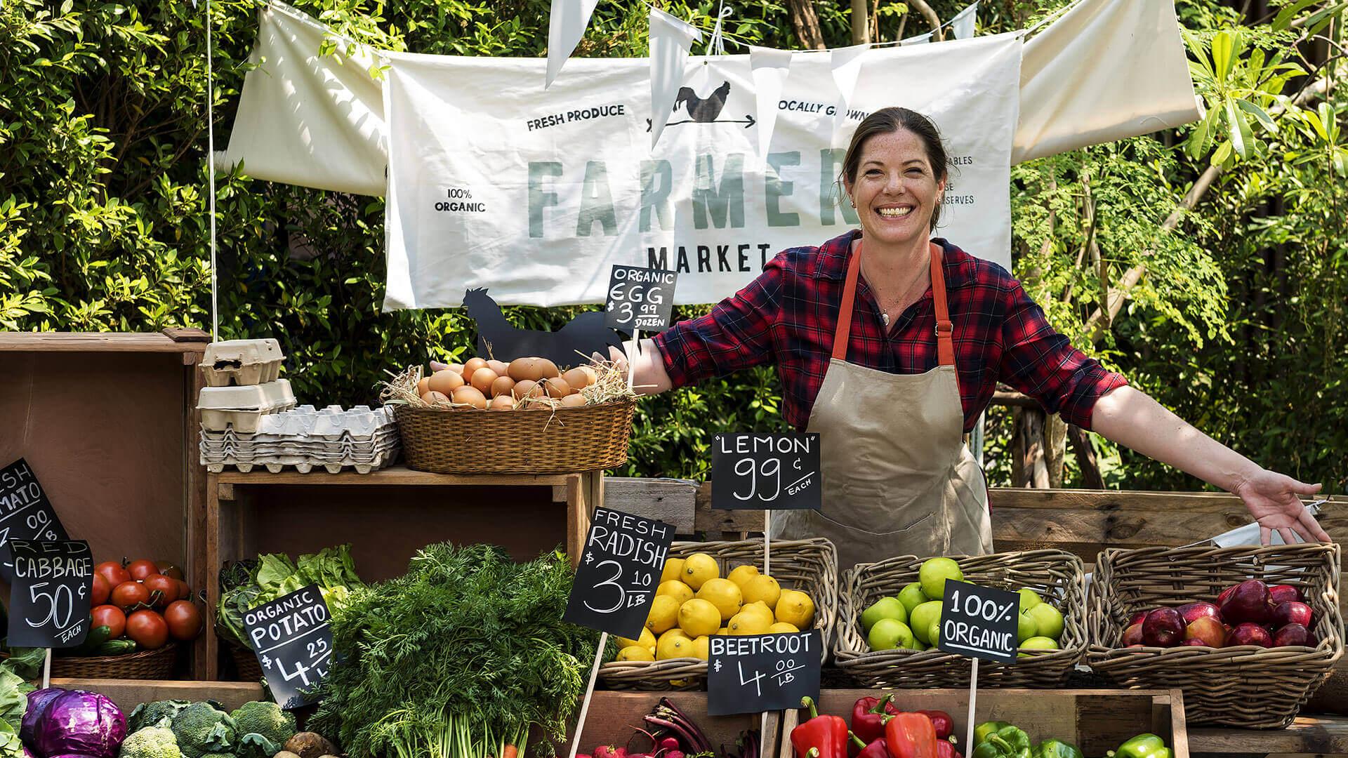 Selling Organic Produce At Farmer Market